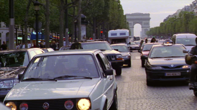walking point of view through stopped traffic on champs elysees with people crossing street / paris, france - sports utility vehicle stock videos & royalty-free footage