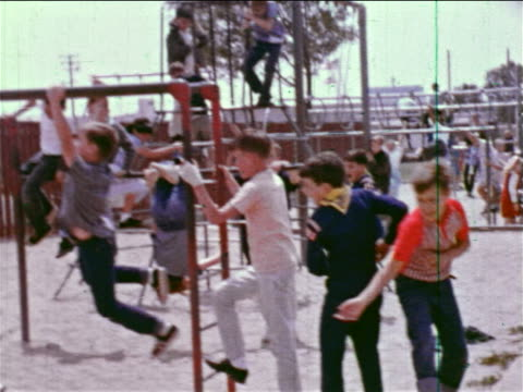 1964 walking point of view thru crowded playground / educational - cub scout stock videos and b-roll footage