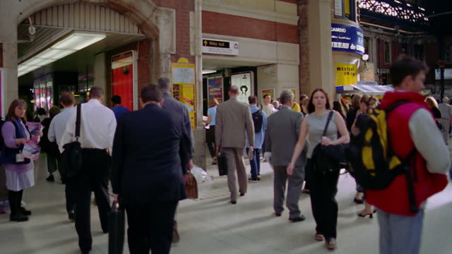 walking point of view pan tilt up tilt down people walking through victoria train station / london, england - station stock videos & royalty-free footage