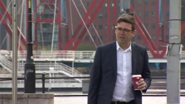 walking shot of andy burnham, mayor of greater manchester - horizontal stock videos & royalty-free footage