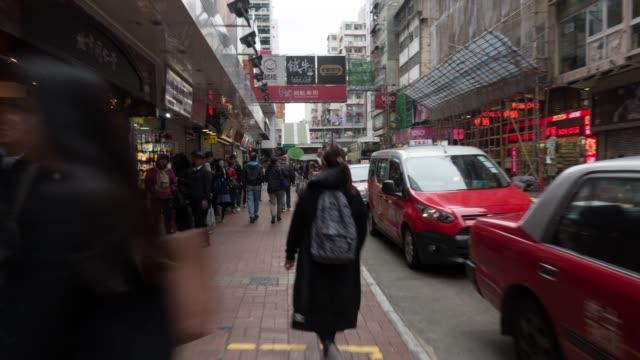 stockvideo's en b-roll-footage met wandelen straatmarkt in hong kong - hong kong