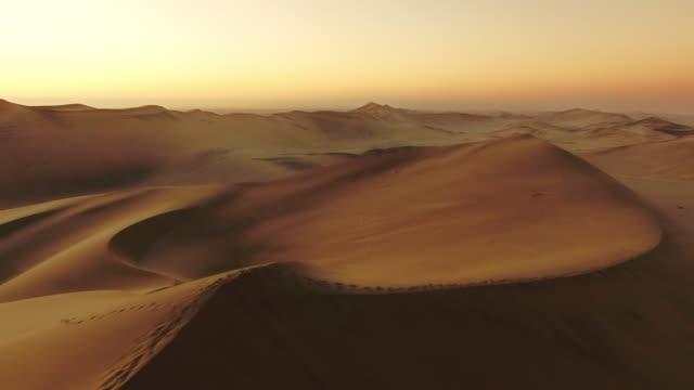 walking thorugh the dunes - namibian desert stock videos and b-roll footage