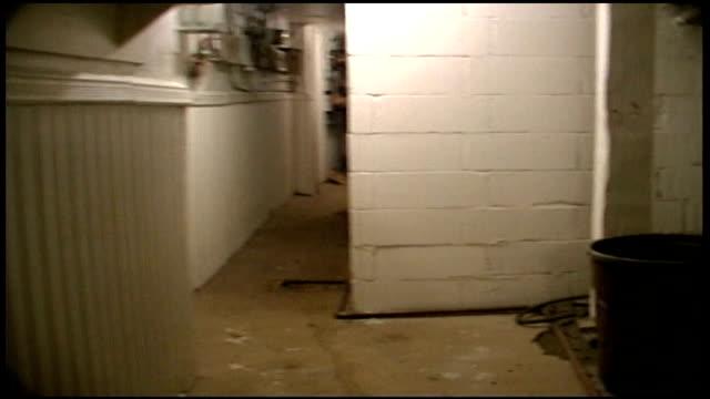 pov of walking through a basement hallway - anno 2002 video stock e b–roll