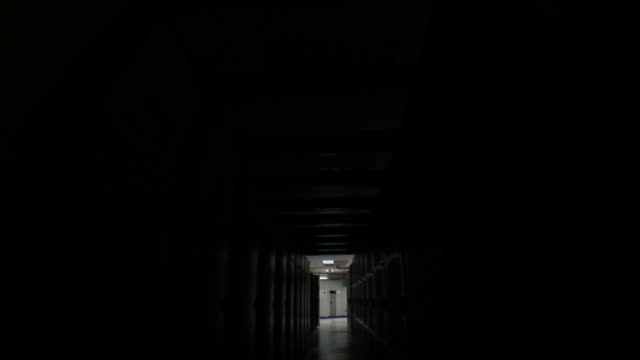ms pov walking through as lights turned on of computer server room / westford, massachusetts, usa  - network server stock videos & royalty-free footage
