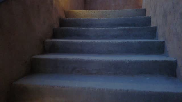 walking through creepy dark stairs with lights on the side - doorway stock videos & royalty-free footage