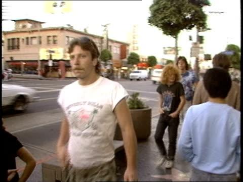 of walking through crowd down sidewalk - punk person stock videos & royalty-free footage