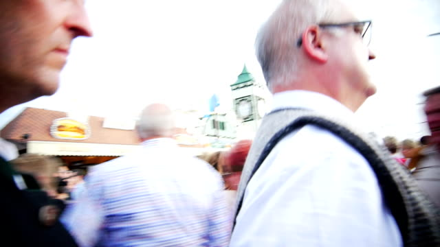 t/l pov walking through crowd of people on oktoberfest - fairground stall stock videos & royalty-free footage