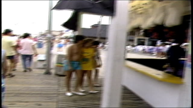 pov of walking through crowd on pt pleasant boardwalk nj - anno 1987 video stock e b–roll