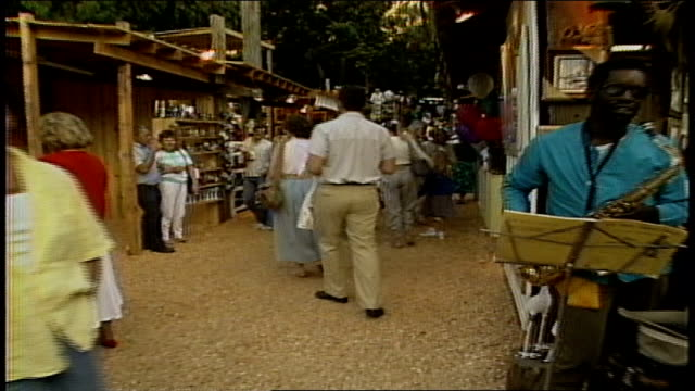 pov of walking through crowded arts and crafts market - anno 1987 video stock e b–roll