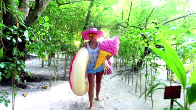walking through jungle after swimming and suffring, maldives - beach bag stock videos and b-roll footage