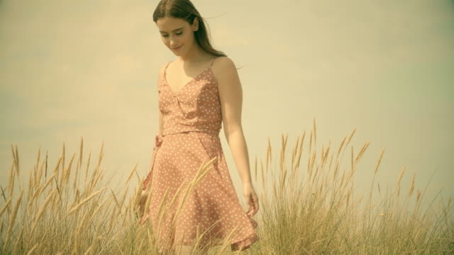 walking through long grass retro style. sm - young women stock videos & royalty-free footage