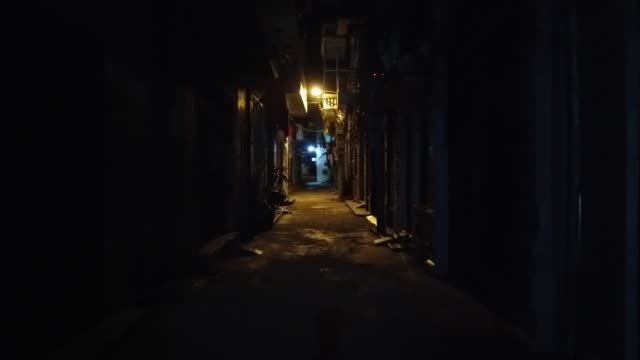 walking through small alleyway in vietnam - dark stock videos & royalty-free footage