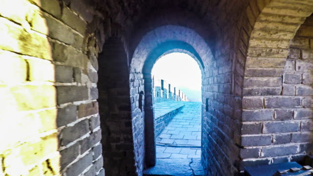 walking through the archway of the mutianyu great wall in beijing, china - great wall of china stock videos & royalty-free footage