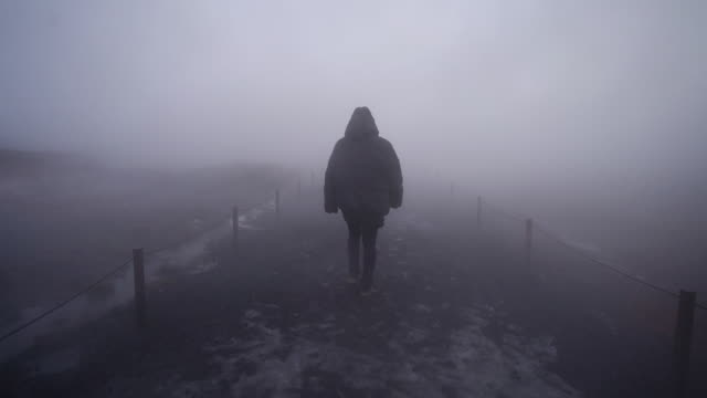 walking through thick fog on iceland - fog stock videos & royalty-free footage