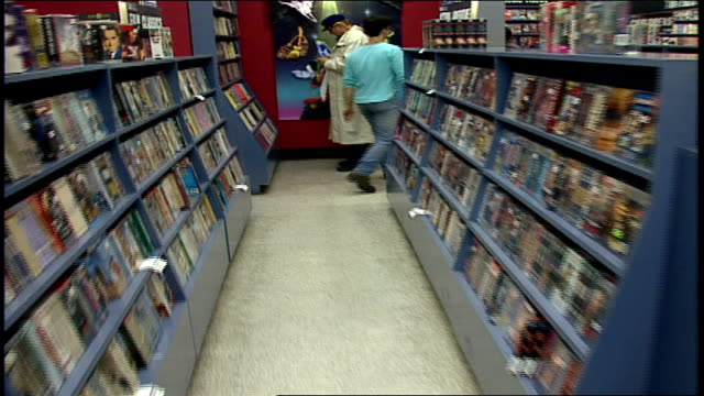pov of walking through tower records movie video sections in nyc - tower records stock videos & royalty-free footage