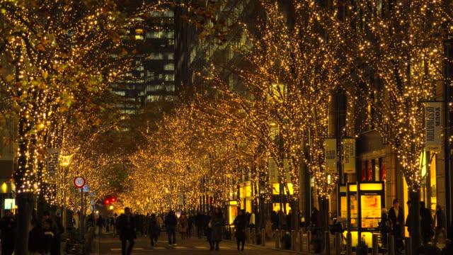 walking through winter illumination at marunouchi,japan - electric lamp stock videos & royalty-free footage