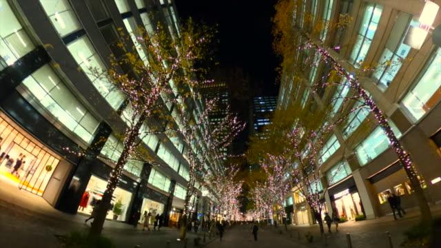 walking through winter illumination at marunouchi,japan - plusphoto stock videos & royalty-free footage
