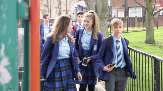 walking to school - schoolgirl stock videos and b-roll footage