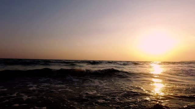walking to sea sunset on sea with smooth shoot stabilizer. - longitude stock videos & royalty-free footage