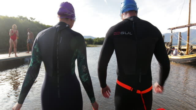 walking to the start of the swim - standing water stock videos & royalty-free footage