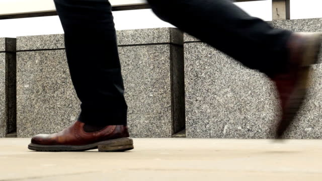 walking to work. commuters legs and feet low angle side view. - low angle view stock videos & royalty-free footage