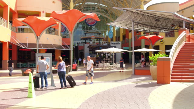 walking towards the stairs at the entrance dolphin mall is a shopping mall in sweetwater miamidade county florida west of the city of miami there are... - miami dade county bildbanksvideor och videomaterial från bakom kulisserna