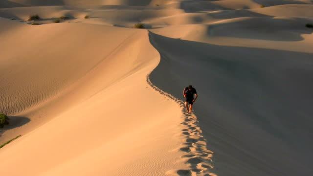 HD: Walking up a sand dune