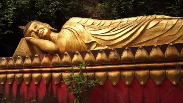 walking up steps to reclining golden buddha, mount phousi, luang prabang, laos - mudra stock videos & royalty-free footage