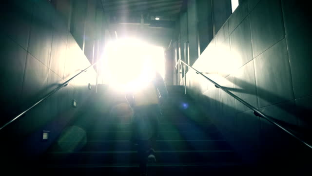 vídeos de stock e filmes b-roll de walking up to light slow-motion - degraus