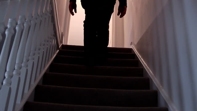 walking upstairs at night. - staircase stock videos & royalty-free footage