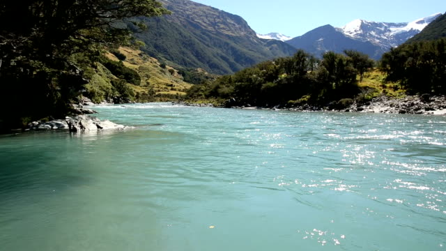 Walking upstream in river shallows