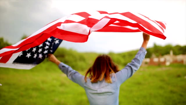 walking with american flag - fourth of july stock videos & royalty-free footage