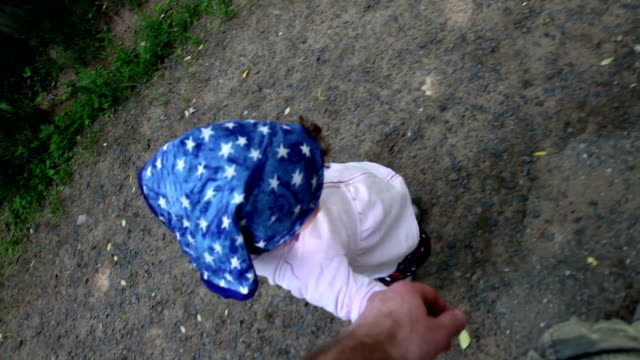 walking with child on the street - genderblend stock videos & royalty-free footage
