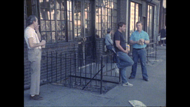 Walking with director Russ Karel past men hanging out outside the Whitehouse Hotel on the Bowery in downtown New York