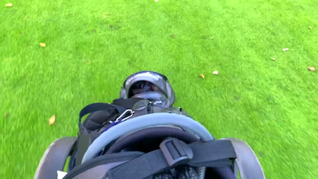 Walking with Golf Bag on the Trolley on Fairway