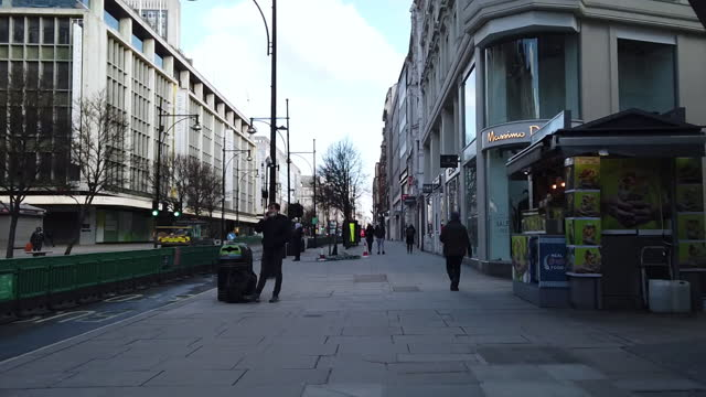 walking with pedestrians on oxford street, hyper lapse, u.k., on wednesday, february 10, 2021. - traffic time lapse stock videos & royalty-free footage