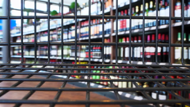 stockvideo's en b-roll-footage met walking with the shopping cart - alcohol