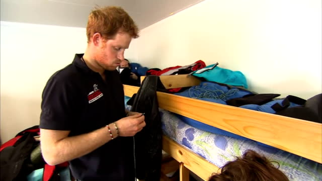 vídeos de stock, filmes e b-roll de walking with the wounded south pole challenge preparations for trek prince harry interview as preparing spare laces for his walking boots sot/ skis... - ski pole