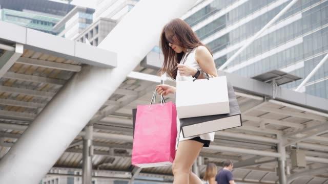 Walking women with shopping bags