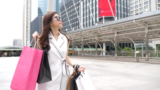 walking women with shopping bags - boutique stock videos and b-roll footage