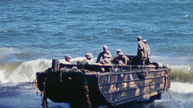 ts walking wounded riding dukw into ocean from shore / iwo jima japan - battle of iwo jima stock videos and b-roll footage