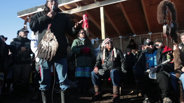Walks With Pride of the Lakota Nation speaks during an interfaith ceremony at Oceti Sakowin Camp on the edge of the Standing Rock Sioux Reservation...