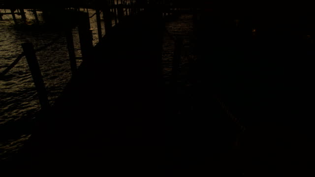 walkway at sunset to overwater bungalows bora bora - polynesian ethnicity stock videos & royalty-free footage
