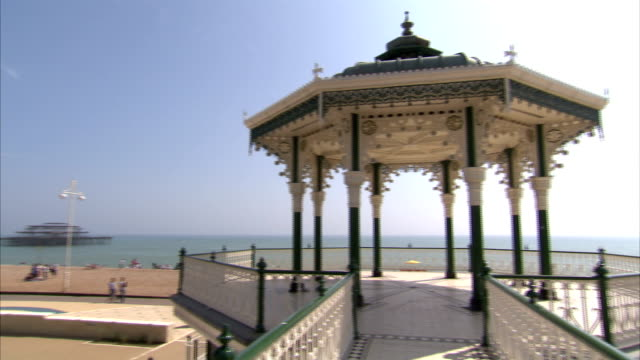 stockvideo's en b-roll-footage met a walkway leads to an elevated gazebo above brighton beach. available in hd. - gazebo