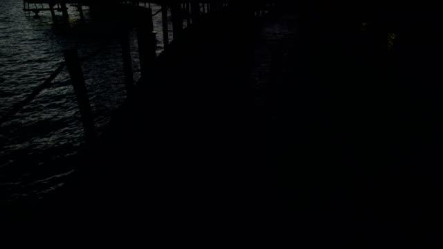 walkway to overwater bungalows at sunrise bora bora - polynesian ethnicity stock videos & royalty-free footage