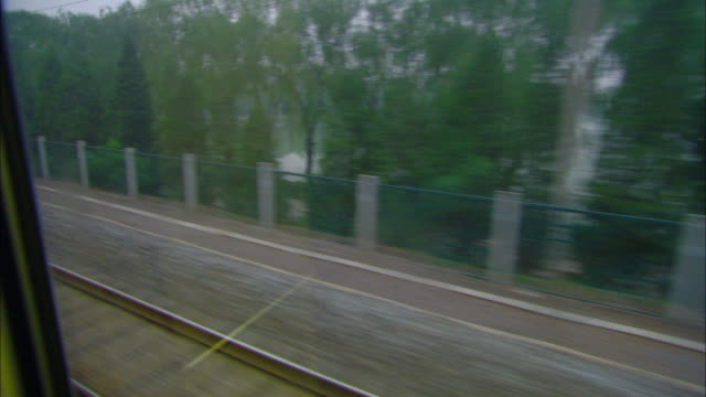 ws pov wall and buildings as seen from moving passenger train, jinan, shandong, china - moving past stock videos & royalty-free footage