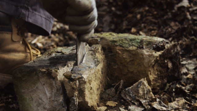 wall builder shaping stone - stone object stock videos and b-roll footage