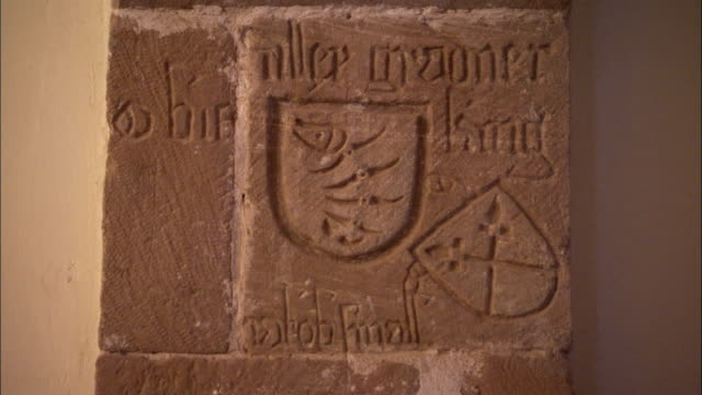 Wall carvings depict names and standards of knights in the old refectory at Saint Catherine's Monastery in Egypt. Available in HD.