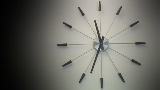 a wall clock. - reversing stock videos & royalty-free footage