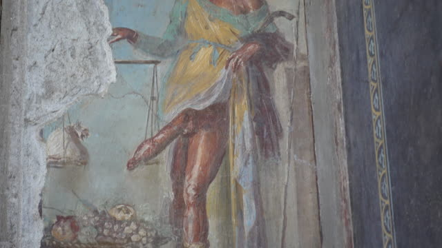 wall fresco artwork painting of a man with a large penis in the ancient ruins of pompeii, italy, europe. - penis stock videos & royalty-free footage